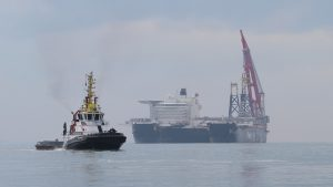 Pioneering Spirit, some tugs